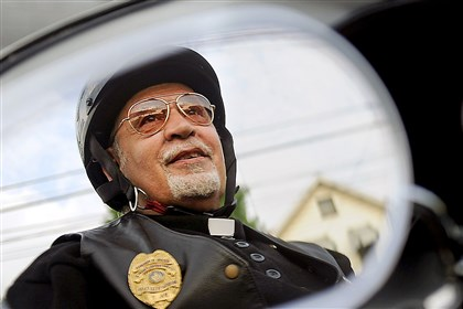 "The Rev. Lou Vallone, pastor of St. John of God Parish in McKees Rocks and St. Catherine of Siena in Crescent, says riding a motorcycle is who he is: ""What you see is what you get."""