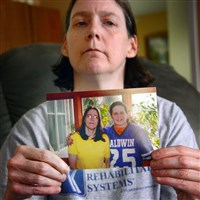Shelley Leininger, 50, holds a picture of herself and son Timothy at her home in Ross Township on Friday. Shelley's son, Timothy Leininger, 27, was pronounced dead Thursday at UPMC Mercy Hospital after being jailed at Allegheny County Jail.