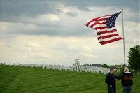 Volunteers put up more than 100 flags Friday for the Memorial Day weekend at the National Cemetary of the Alleghenies.
