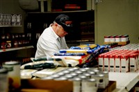 Matthew Alexander of Sewickley organizes shelves at the Northside Community Food Pantry where he volunteers.