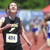 Quaker Valley's Hannah Bablak celebrates after winning the Class AA 1,600-meter run at the PIAA championships.