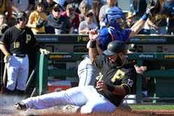 Pedro Alvarez beat the throw and slides safely into home against the Mets on Saturday