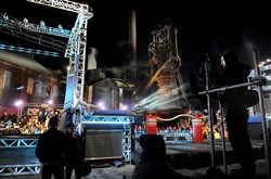 "Camera crews wait for a contestant with the remains of the Carrie Furnace lit in the background during filming of  ""American Ninja Warrior"" last month."