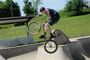 Jordan Gozdich, 17, takes advantage of Saturday's sunshine to practice some bike tricks at the South Park BMX track and Skate Park.