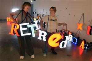 MaryEllen Lammel, left, of Upper St. Clair and Noreen Nalitz of Peters spell out retired, which they both are, at the Pittsburgh Glass Center in Friendship.