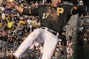 Pirates shortstop Jung Ho Kang slides safely into home against the Mets at PNC Park.