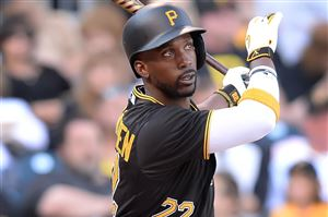 Pirates center fielder Andrew McCutchen doubles against the Mets at PNC Park on Saturday.