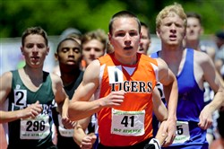 Beaver Falls' Domenic Perretta sets the pace in the Class AA 1,600-meter run at the PIAA track and field championships. Perretta won the race and also took the 800-meter run to finish with two gold medals.