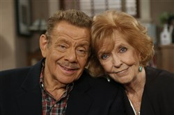 "In this Nov. 6, 2003, file photo, Jerry Stiller, left, and his wife Anne Meara pose on the set of ""The King of Queens,"" at Sony Studio in Culver City, Calif. Meara, whose comic work with husband helped launch a 60-year career in film and TV, has died. She was 85."