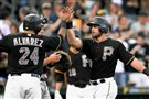 Teammates congratulate Francisco Cervelli after hitting a three run homer against the Marlins in Monday night's 4-2 win over Miami at PNC Park.