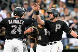 Teammates congratulate Pirates' Francisco Cervelli after hitting a three run homer against the Marlins Monday night at PNC Park.