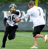 Steelers quarterback Ben Roethlisberger hands off to LeVeon Bell during the first day of OTAs at the Steelers South Side Training facility on May 26, 2015.