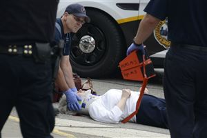 A pedestrian is treated after being hit by a vehicle at the McKee Place and Forbes Avenue intersection in Oakland.