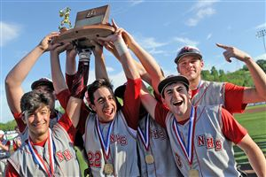 Neshannock teammates hold their trophy after defeating Quaker Valley in the WPIAL Class AA baseball championship at Consol Energy Park in Washington.