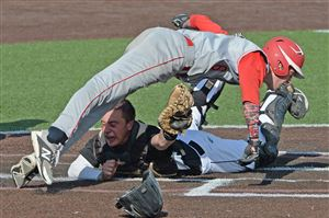 Quaker Valley catcher John Medich reaches to tag out Neshannock's Jason Swope after he missed home plate in the WPIAL Class AA baseball championship at Consol Energy Park in Washington.