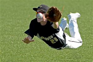 Quaker Valley's Joey Hess dives for a fly ball hit by Neshannock in the WPIAL Class AA baseball championship at Consol Energy Park in Washington.