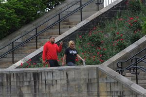 Todd Schatzman and Talitha Harrison head to their car after walking several laps around the Highland Park Reservoir.