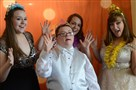 Dominic Rizzo poses for a photograph with Toni DiPippa, Samantha DiPippa and Hannah Ranalli during a prom for special need students inside the Grand Ballroom at the William Penn Hotel.