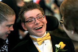 Alex Arch, 16, of Keystone Oaks, shares a laugh during a prom for special needs students Wednesday inside the Grand Ballroom at the William Penn Hotel.