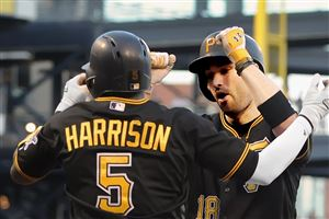 Pirates second baseman Neil Walker is greeted at home by Josh Harrison after hitting a two-run homer against the Marlins at PNC Park.