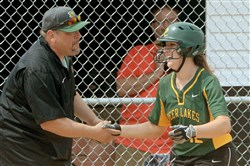Deer Lakes' Maria Taliani is congratulated by coach Craig Taliani after hitting a grand slam against Mohawk in the WPIAL Class AA softball championship last season.