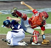 Knoch's Garrett Traggiai, left, upends West Allegheny catcher Brandon Pouch in the WPIAL Class AAA championship Wednesday night at Consol Energy Park in Washington.