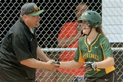 Deer Lakes' Maria Taliani is congratulated by coach Craig Taliani after hitting a grand slam against Mohawk in the WPIAL Class AA softball championship last month.