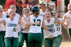 Belle Vernon's Emily Frederick (13) is mobbed by her teammates after hitting the game winning single to score two runs against Yough in the WPIAL Class AAA softball championship at California University Thursday.