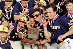 Central Catholic players celebrate the school's first WPIAL baseball title Wednesday at Consol Energy Park in Washington. The Vikings defeated Norwin, 2-0, for the Class AAAA championship.