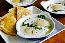 Baked eggs with Spinach, Yogurt and Sumac can be a rustic brunch or dinner.