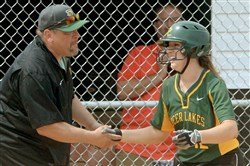 Deer Lakes' Maria Taliani is congratulated by head coach Craig Taliani after hitting a grand slam against Mohawk in the WPIAL Class AA softball championship at California University.