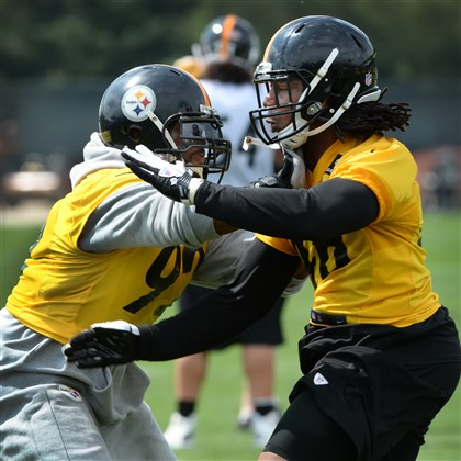 James Harrison blocks rookie Bud Dupree during OTA's at the Steelers' training facility on the South Side.