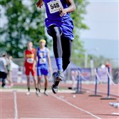 Trinity Christian's Tyler Carter competes in the Class AA triple jump at the PIAA track and field championships last Friday at Shippensburg University. Carter won the event with a leap of 47 feet, 3/4 inch.