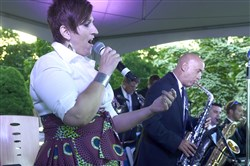 Tania Grubbs, left, sings with the Benny Benack Band at Phipps' Jazz in the Garden last year at Phipps Conservatory and Botanical Gardens. She will perform with her quartet Saturday at Riverview Park.