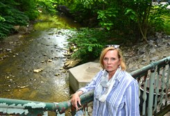 Lisa Brown, coordinator of the new Saw Mill Run Watershed Association, stands Friday near Saw Mill Run in Overbrook. The nonprofit initiated a project last year to link the health of the stream to other improvements being considered for Route 51.