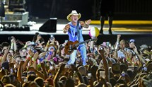Kenny Chesney's concerts are known for their raucous atmosphere. This year, fans will be encouraged to clean up after themselves.