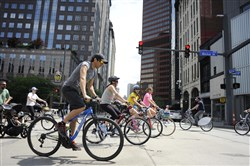 Bicyclists cross Liberty Avenue, Downtown, as part of the Open Streets Pittsburgh event on May 31.