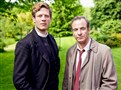"James Norton as vicar Sidney Chambers and Robson Green as Inspector Geordie Keating star in ""Masterpiece: Mystery! Grantchester,"" which PBS will likely renew for a second season."