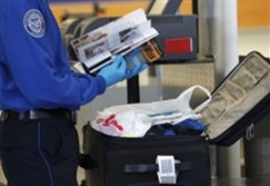 A Transportation Security Administration (TSA) officer inspects items from a piece of luggage at Los Angeles International Airport in Los Angeles.