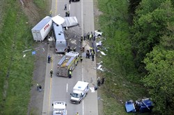 Authorities investigate the scene of a fatal collision between a tractor-trailer and a tour bus on Interstate 380 near Mount Pocono, Pa., in 2015. For the first time, Pennsylvania State Police are making crash reports available online.