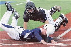 Knoch's Dustin Montgomery slides safely into home past Montour catcher Billy Krull Thursday at West Mifflin.