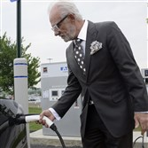 In this June 2015 photo, Robert DelLucia, CEO of Star Transportation Group, charges his electric car at the Sunoco APlus at the Pittsburgh International Airport.