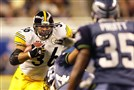 Steelers tailback Jerome Bettis carries against the Seahawks during Super Bowl XL in February 2006.