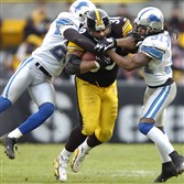 Former Steelers running back Jerome Bettis is hauled down by the Bracy Walker and RW McQuarters at Heinz Field in a 2006 game. The Steelers and Lions will practice together during 2016 training camp.