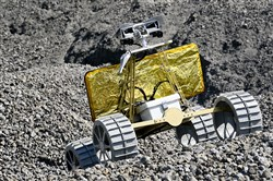 """Charlie,"" an aspiring lunar rover, runs over some of the slag at the LarFarge North America complex in West Mifflin.  Charlie, made by Astrobotic and Carnegie Mellon University, is competiting in the Google Lunar XPrize race to the moon."