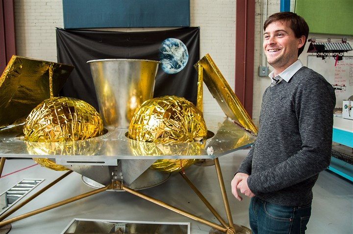 ASTROBOTIC0611a John Thornton, CEO of Astrobotic, stands in front of the company's Griffin Lander at their headquarters in the Strip District.