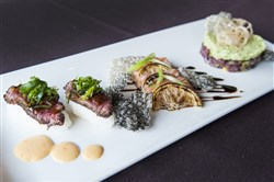 The Raw Deal: from left, hanger steak nigiri with seaweed salad and spice aioli, salmon sashimi with torched lemon, yuzu ponzu and scallions, and tuna tartare with garlic scapes, garbanzo bean wasabi hummus and lotus root chips.