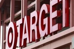 The signs at Target labeling items by gender are in the process of being removed, the retailer announced Monday.