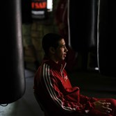 Hugo Garcia, a Pittsburgh boxer, takes a break from preparing for the Olympic qualifying tournament.