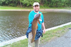 Baited up with french fries, Michael Kirshenbaum of Squirrel Hill landed a 30-inch common carp at Panther Hollow Lake in Schenley Park.